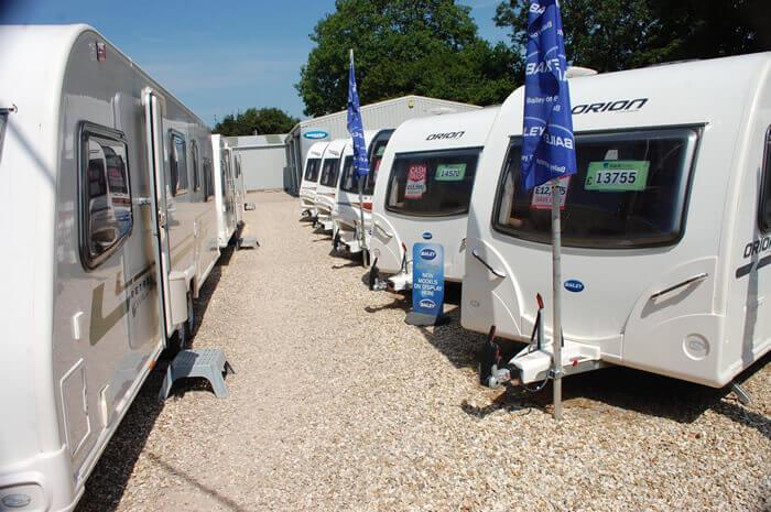 Used Caravan yard 2 in the summer sunshine